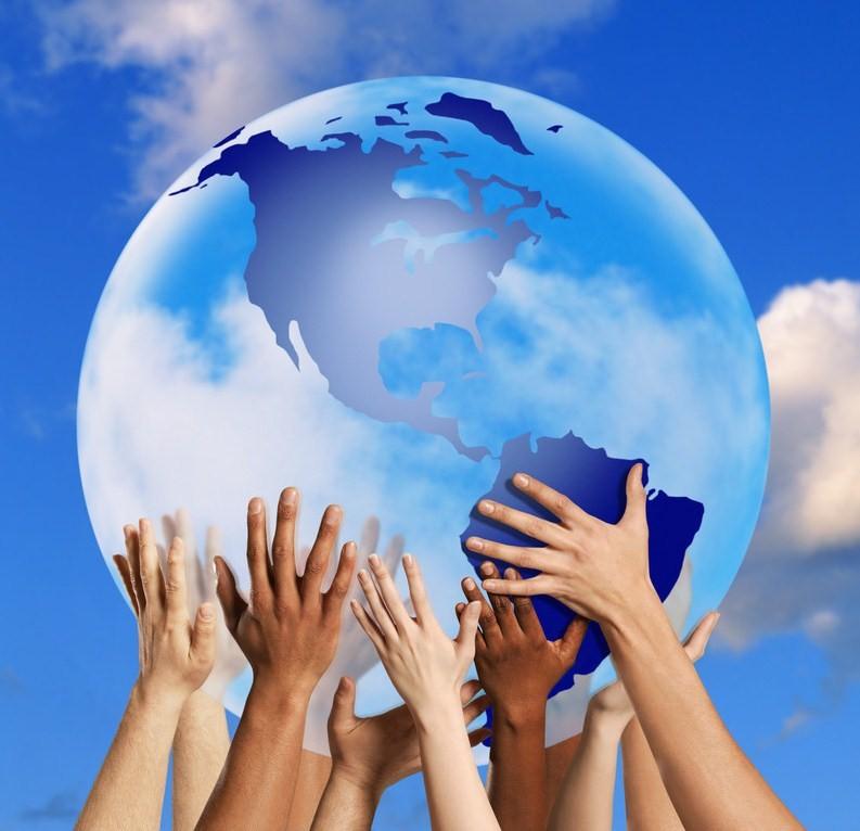 Hands touching a globe